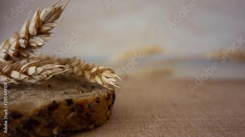 Valokuva  Wheat ears on rustic wooden background