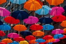 Colorful Umbrellas Hanging Nex...