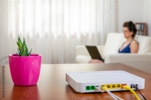 Photo Modem router on a table in a living room
