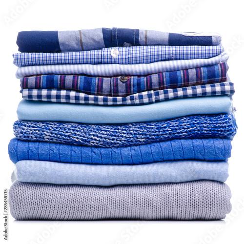 Leinwand Poster Stack folded blue shirt clothing on white background isolation