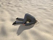 Businessman Hiding His Head In...