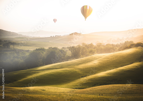 beautiful foggy landscape in Tuscany at sunset during summer Wallpaper Mural