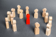 Red Human Figure Surrounded By A Group Of People. Leader Boss And Leadership. Cooperation And Teamwork. Outcast, Hated Opponent, Criminal. Conviction. Discrimination And Violence.