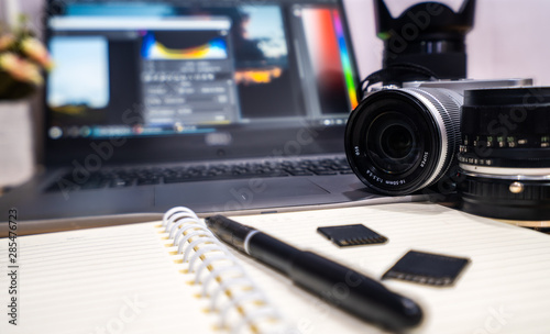 Obraz Photographer concept Work space photographer with DSLR camera lense and computer laptop - fototapety do salonu