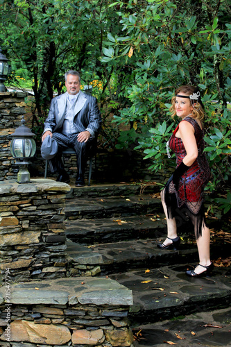 portrait of a man and woman in a park Wallpaper Mural