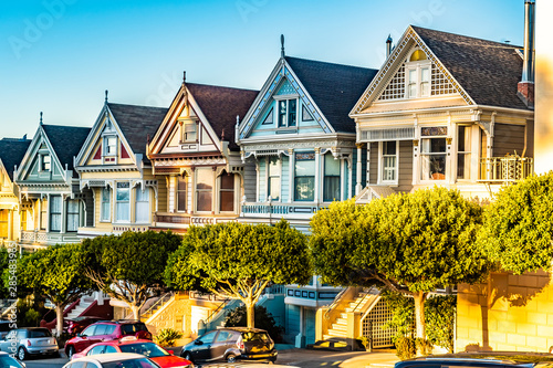 Row of charming colored Victorian style homes on the incline of the hills of San Francisco city, California Wallpaper Mural