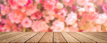 Abstract Blur Beautiful Flowers And Floral Background In Beauty Shop With Brown Wooden Tabletop Texture Perspective Counter For Promote And Show And Advertise Product On Display