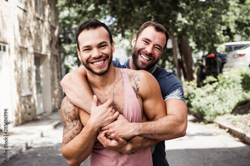 A Portrait of a happy gay couple outdoors in urban background Canvas Print