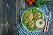 Baked Patty Pan Squash stuffed with meat and cheese, greens. Wood background.