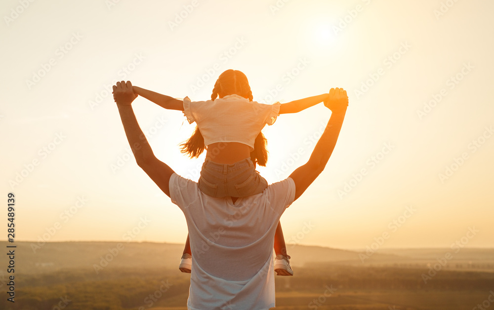 Fototapeta Anonymous father and daughter during sundown