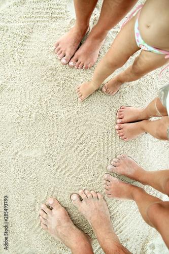 Family feet on the sand on the beach Wallpaper Mural