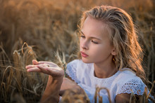 Girl Examines A Ladybug In The...