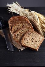 Freshly Baked Bread On Wooden Board. Cutted Organic Bread
