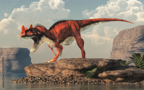 Naklejki dinozaury  ceratosaurus-was-a-carnivorous-theropod-dinosaur-of-the-jurassic-era-most-notable-for-the-horns-on-its-snout-over-its-eyes-on-a-rock-by-a-lake-3d-rendering