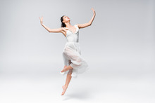 Young Elegant Ballerina In Whi...