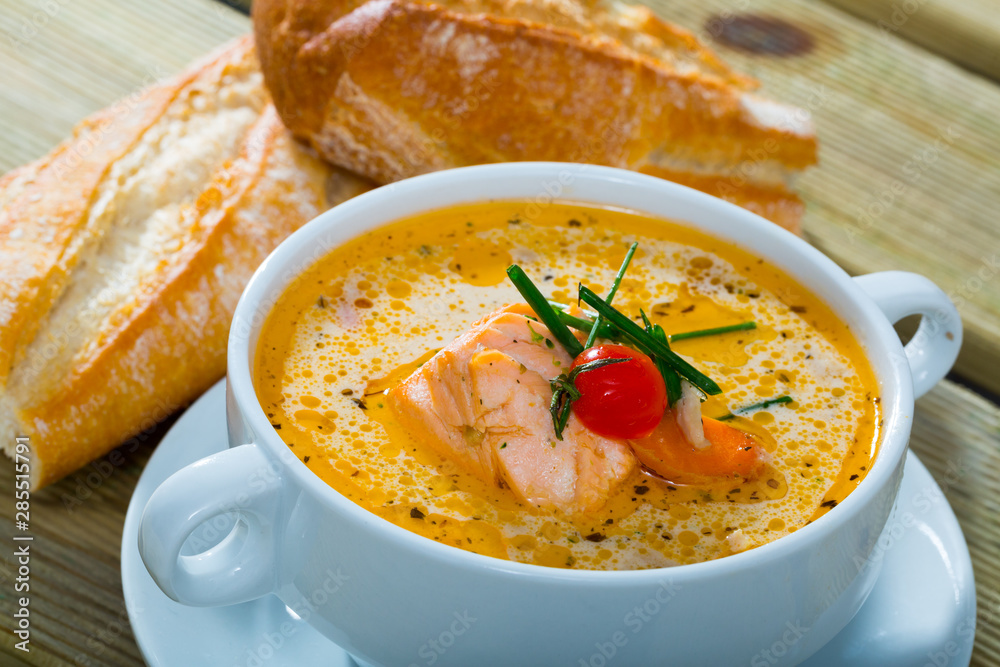 Obraz Cream salmon soup with carrots and potatoes served in bowl fototapeta, plakat