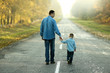 Leinwandbild Motiv father and son walk in nature