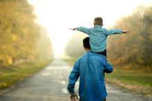 Father And Son Walk In Nature