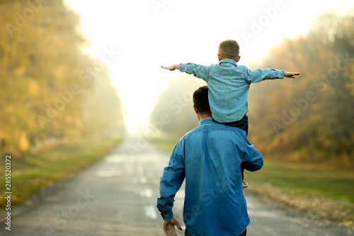 obraz PCV father and son walk in nature