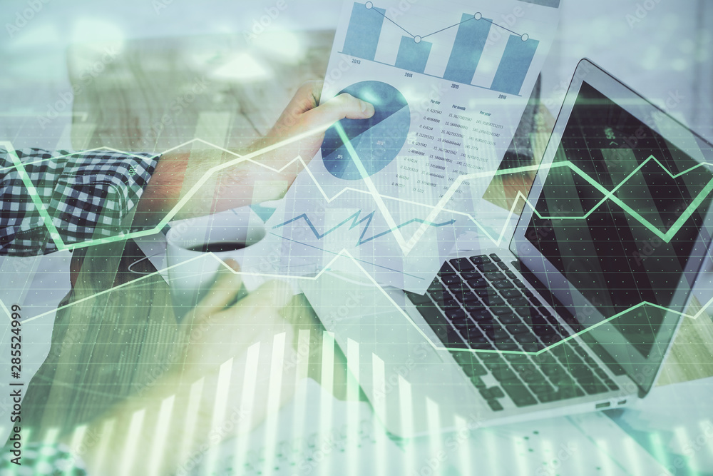 Fototapety, obrazy: Double exposure of man's hands writing notes with laptop of stock market with forex graph background. Top View. Concept of research and trading.