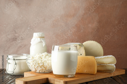 Printed kitchen splashbacks Dairy products Fresh dairy products and cutting board on wooden background, copy space