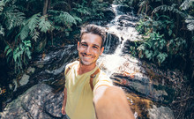 Happy Young Man Take A Selfie On A Excursion In The Forest At Summe