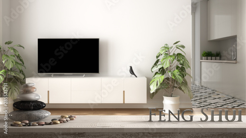 White table shelf with pebble balance and 3d letters making the word feng shui o Wallpaper Mural