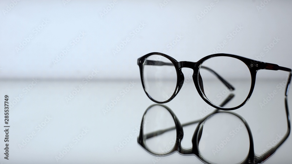 Fototapeta Classic eyeglasses with diopters on table in ophthalmologist office, diagnostics