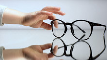 Child Hand Taking Spectacles, Diagnosis Of Kid Eyesight, Ophthalmology Help