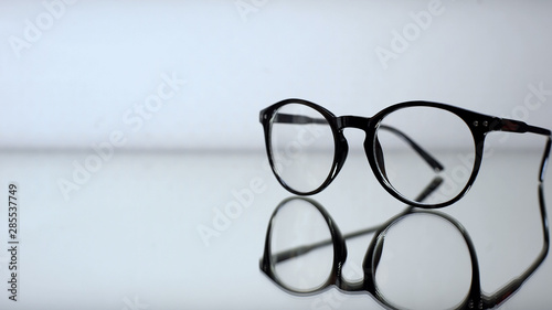 Classic eyeglasses with diopters on table in ophthalmologist office, diagnostics Fototapeta