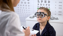 Cute Girl In Optical Trial Frame Waiting Prescription From Ophthalmologist