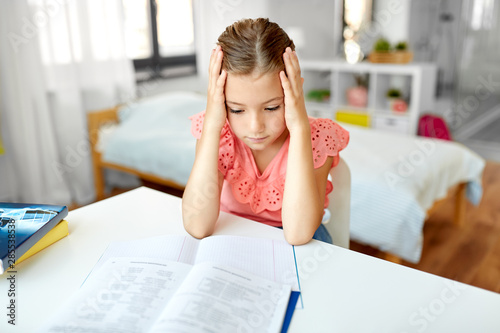 Photo sur Toile Les Textures children, education and learning concept - sad student girl with notebook at home
