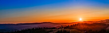 Panorama Of Sunset Over Hills, Forest, Countryside