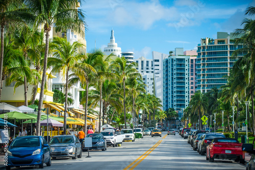 Fotografie, Tablou  Bright scenic view of Ocean Drive in South Beach, Miami on a light traffic morni