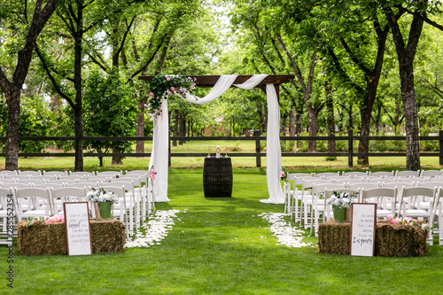 Fototapeta  wedding ceremony with arch and trees