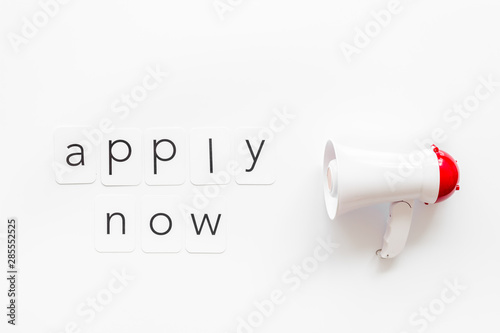 Valokuva  Apply now announcement symbol with megaphone and text on white background top vi