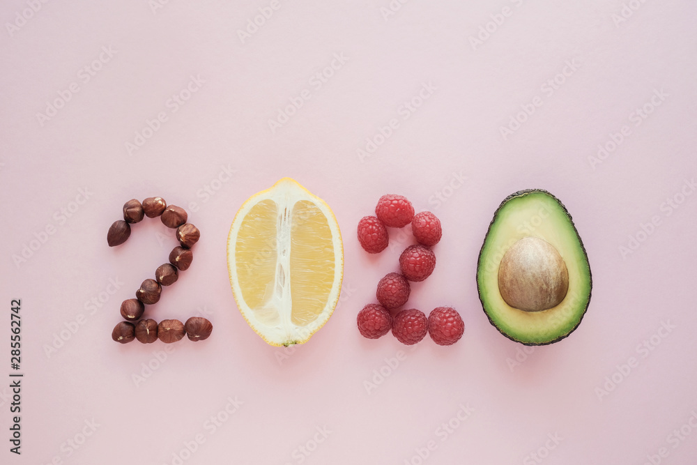 Fototapeta 2020 made from healthy food on pastel pink  background, Healhty New year resolution diet and lifestyle