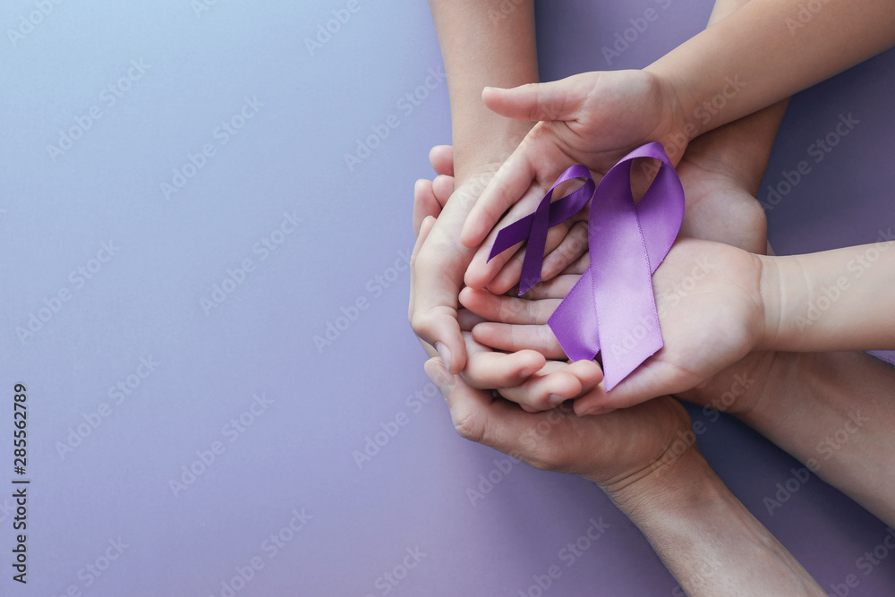 Fototapeta Adult and child hands holding purple ribbons, Alzheimer's disease, Pancreatic cancer, Epilepsy awareness, world cancer day on purple background