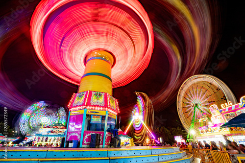 Carnival rides all lit up at night #285572349