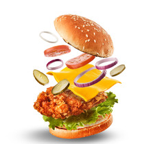 Burger With Flying Ingredients. Delicious Monster Hamburger Cheeseburger Explosion Concept Flying Ingredients