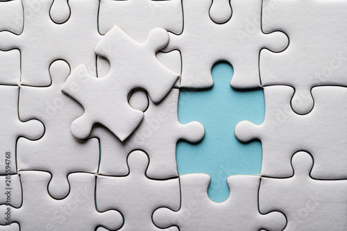 Fotografija  Jigsaw puzzle with missing piece. Missing puzzle pieces