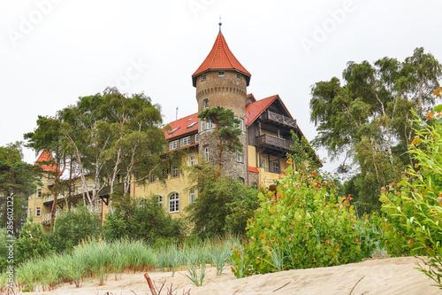 Fotografie, Obraz LEBA, POLAND - JULY 23, 2019: Neptun Castle on the Baltic Sea in Leba, Poland