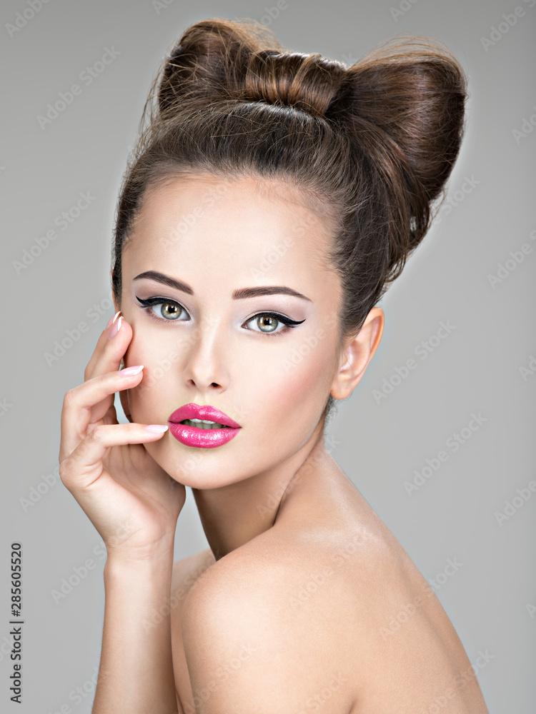 Fototapeta Beautiful woman with stylish bow hairstyle.
