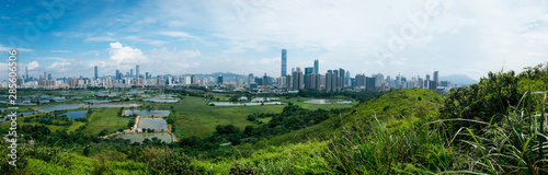 Photo sur Aluminium Bleu ciel Panorama view of rural green fields with fish ponds between Hong Kong and skylines of Shenzhen,China
