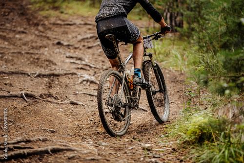 male cyclist riding uphill mountainbike race in forest Canvas Print