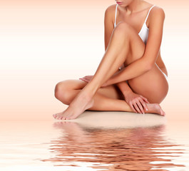 FototapetaYoung woman with slim body and smooth clean skin. Laser hair removal concept
