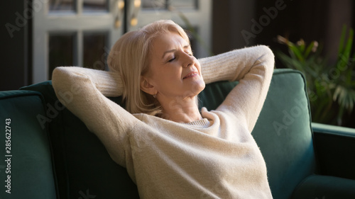 Carta da parati  Calm happy old woman relaxing with eyes closed on couch