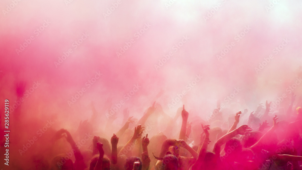Fototapety, obrazy: Red and pink holi colors over the crowd