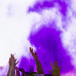 Leinwanddruck Bild - Purple holi color over the people raising their hand dancing