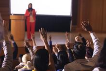 Businesswoman Standing Around The Podium In The Auditorium